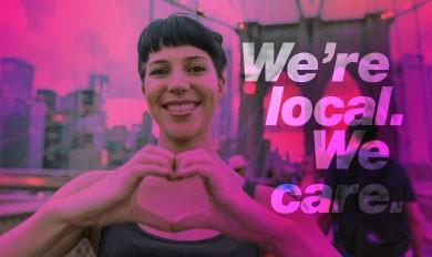 young women on Brooklyn bridge showing heart symbol
